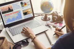 Young women planning vacation trip. And searching information or booking an hotel on laptop stock images