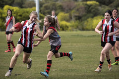 Females playing Australian Rules Football Royalty Free Stock Photo