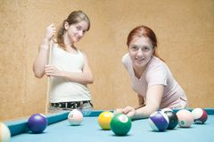Young  women playing billiards Royalty Free Stock Photo