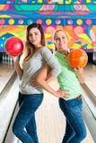Young women playing bowling and having fun Stock Photo