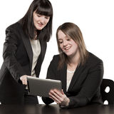 Young women playing on Ipad Royalty Free Stock Photo