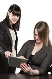 Young women playing on Ipad Stock Photography