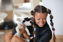 Young women playing with puppy Stock Photography