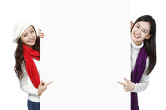 Young Women Pointing At Blank Space Stock Photography