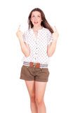 Young women pointing up royalty free stock photo