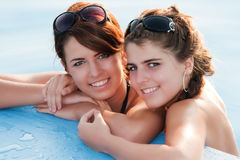 Young women in pool. Young women relaxing in the water. Summer royalty free stock photo