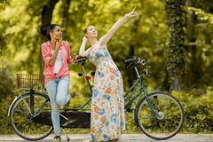 Young women posing by the bicycle Royalty Free Stock Photography