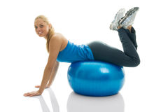 Young women posing on fitness ball Royalty Free Stock Photo