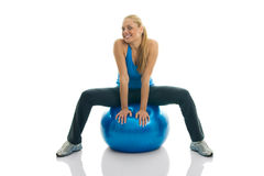 Young women posing on fitness ball. Isolated on white Stock Photography