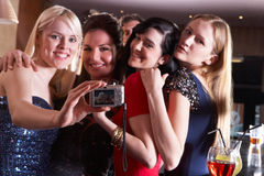 Young women posing at party. With camera royalty free stock photo