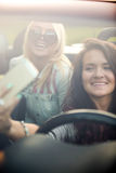 Young women posing for selfie in car Stock Photo