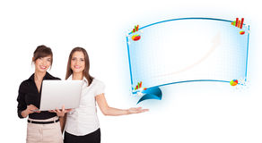 Young women presenting abstract copy space with diagrams and gra Stock Images