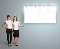 Young women presenting modern copy space Royalty Free Stock Photos