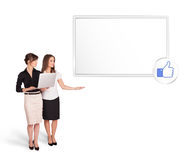 Young women presenting modern copy space Royalty Free Stock Photo