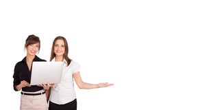 Young women presenting white copy space Royalty Free Stock Photo