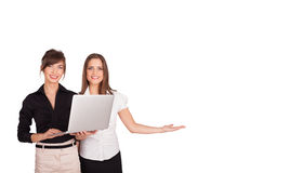 Young women presenting white copy space Stock Photos