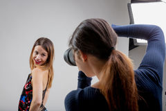 Young model with young photographer Royalty Free Stock Photo