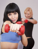 Young women are punching with handweights Stock Photography