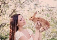 young women with rabbit Stock Photo
