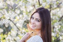 young women with rabbit Stock Images