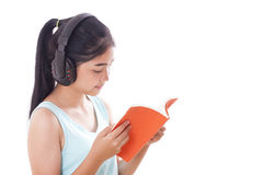 Young women reading book and listening music. Young woman reading book and listening music isolated on white background Royalty Free Stock Images