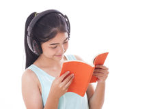 Young women reading book and listening music. Young woman reading book and listening music isolated on white background Royalty Free Stock Photography