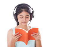Young women reading book and listening music. Young woman reading book and listening music isolated on white background Stock Photography