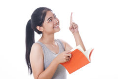 Young women reading a book. Young woman reading a book and pointing up Stock Images
