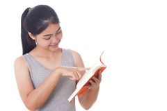 Young women reading a book. Young woman reading a book and pointing up Stock Photo