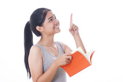 Young women reading a book. Young woman reading a book and pointing up Stock Photos