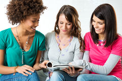 Young Women Reading Magazine Royalty Free Stock Image