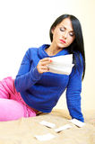 Young women reading medicine instruction Royalty Free Stock Photos