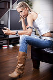 Young women reading text message Royalty Free Stock Images