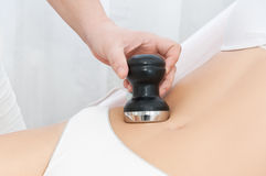 Young woman receiving cavitation treatment Stock Photography