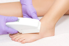 Young woman receiving epilation laser treatment Royalty Free Stock Photos