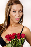 Young woman receiving red rose Stock Images