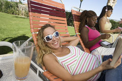 Young Women Relaxing On Deck Chair Royalty Free Stock Image