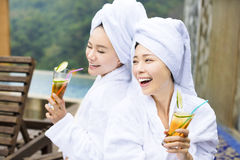 Young Women relaxing and drinking tea after spa Stock Photo