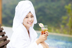 Young Women relaxing and drinking tea in spa salon Stock Photo