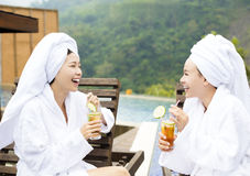 Young Women relaxing and drinking tea in spa salon Royalty Free Stock Photography