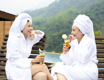 Young Women relaxing and drinking tea in spa salon Stock Images