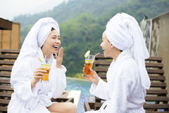 Young Women relaxing and drinking tea in spa salon Stock Image
