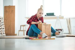 Young women repairing furniture at home royalty free stock image