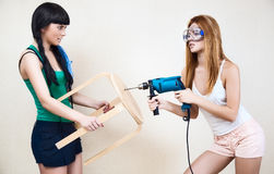 Young women repairing stool Royalty Free Stock Images