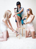 Young women repairing stool Stock Photography