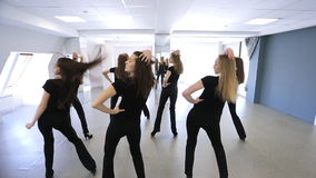 Young women are repeating dance movements in model school. stock video
