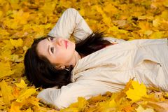 Young women rest on the autumn leaf Stock Photos
