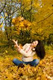 Young women rest on the autumn leaf Royalty Free Stock Photography