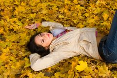 Free Young Women Rest On The Autumn Leaf Royalty Free Stock Photography - 6975117
