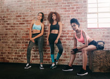 Young women resting after workout in gym Royalty Free Stock Photos